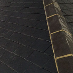 edge of roof with slate roof tiles